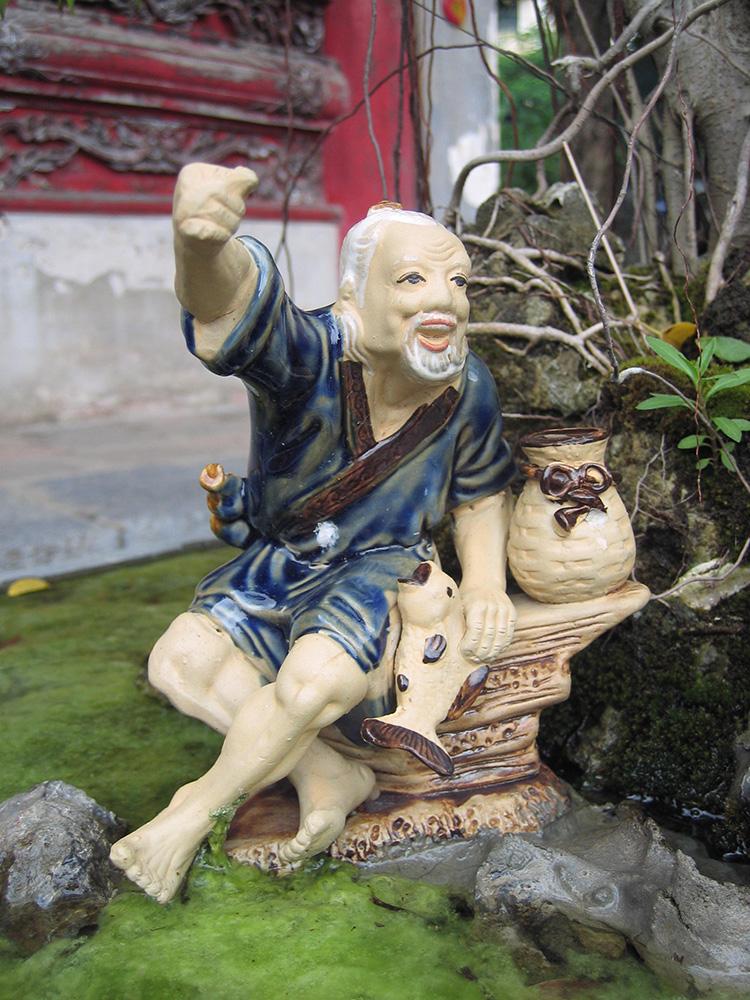 Figurine sur un bonzai